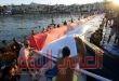 رفع أكبر علم المصرى فوق سطح مياة البحر الأحمر بمدينة شرم الشيخ.